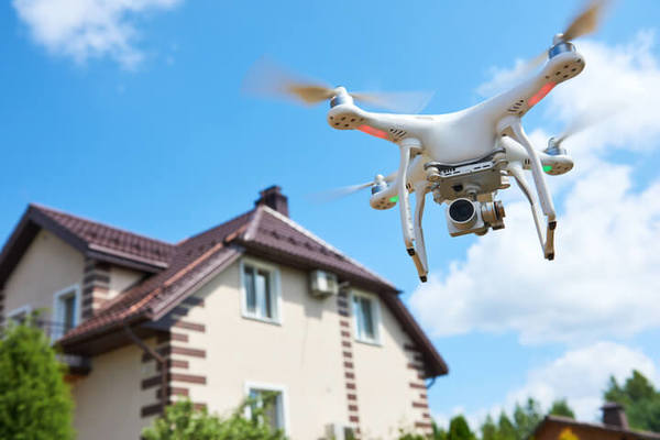 flying drones over real estate